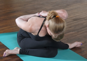 gomukhasana (cow face pose), photo credit: Courtney Long