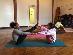 Chloe and Ashley in partner boat pose, Tweens Yoga, February 2015
